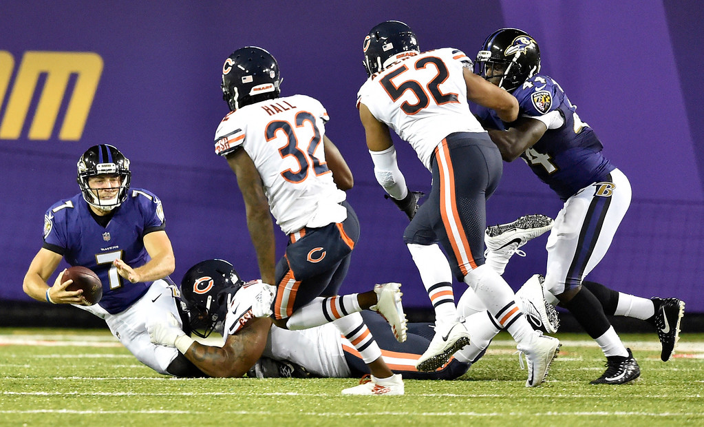 . Baltimore Ravens quarterback Josh Woodrum (7) is sacked in the first half against the Chicago Bears at the Pro Football Hall of Fame NFL preseason game, Thursday, Aug. 2, 2018, in Canton, Ohio. (AP Photo/David Richard)