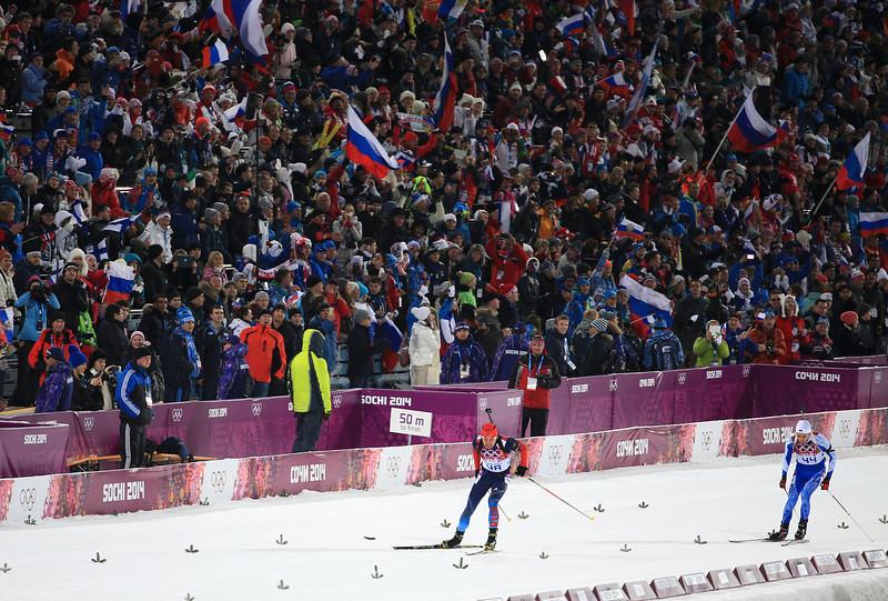 . Anton Shipulin (R) of Russia and Danil Steptsenko of Estonia compete in the Men\'s Sprint 10 km during day one of the Sochi 2014 Winter Olympics at Laura Cross-country Ski & Biathlon Center on February 8, 2014 in Sochi, Russia.  (Photo by Richard Heathcote/Getty Images)