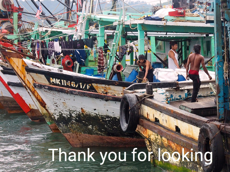 Fishermen on their boats in the South China Sea