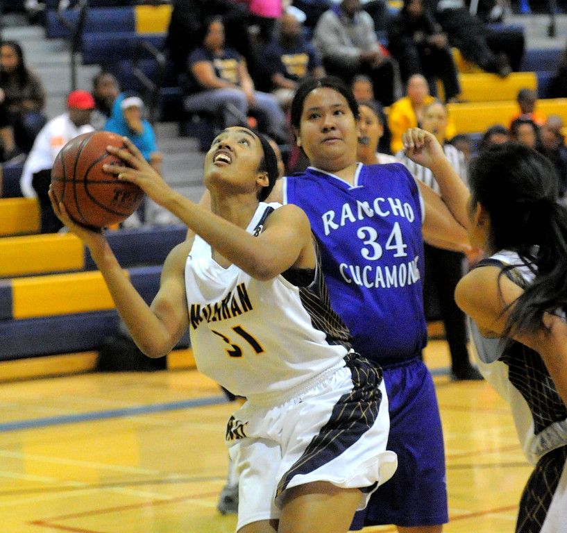 . 02-16-2012--(LANG Staff Photo by Sean Hiller)- Millikan vs. Rancho Cucamonga in Saturday night\'s  first-round CIF girls basketball game at Millikan High School in Long Beach. Alyssa Benton (31) goes to the basket against Rancho\'s Marisa Lopez.