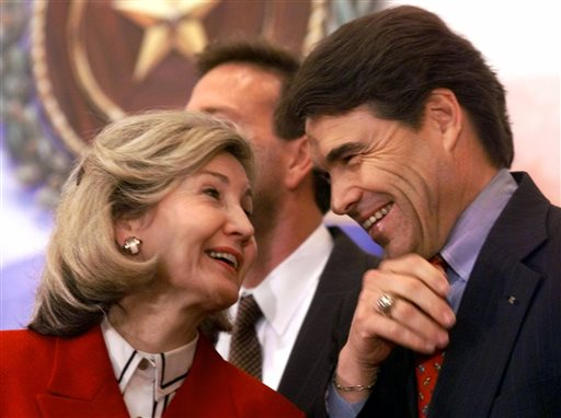 . FILE - In this March 13, 2000 file photo, Texas Lt. Gov. Rick Perry, right, shares a laugh with Sen. Kay Bailey Hutchison, R-Texas, during a news conference in Austin, Texas. Perry announced Monday, July 8, 2013, that he would not seek re-election as Texas governor next year.  (AP Photo/Harry Cabluck, File)