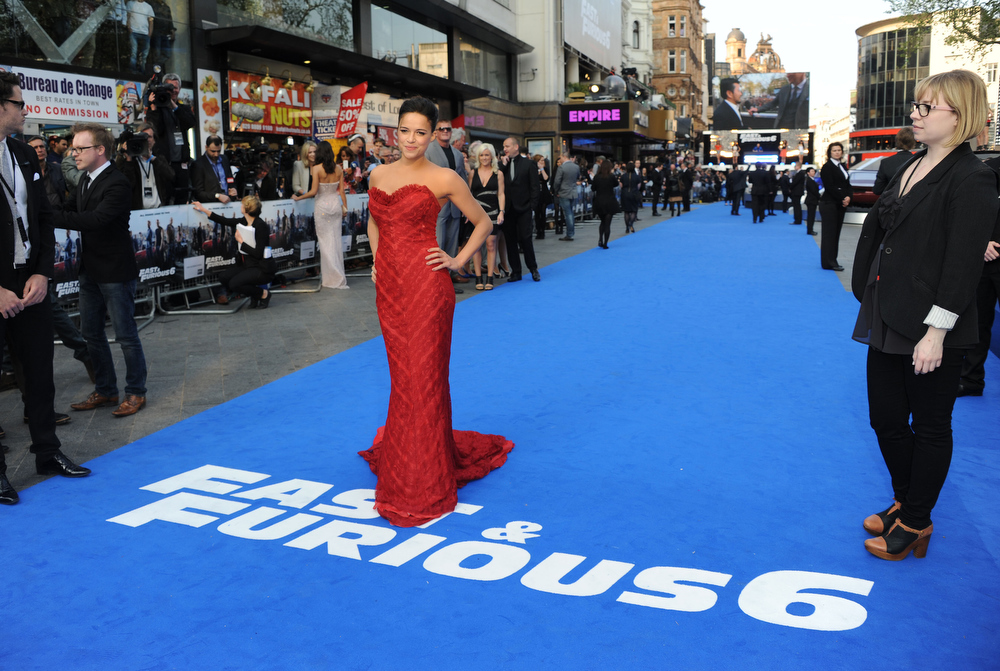 ". Actress Michelle Rodriquez attends the ""Fast & Furious 6\"" World Premiere at The Empire, Leicester Square on May 7, 2013 in London, England.  (Photo by Stuart C. Wilson/Getty Images for Universal Pictures)"