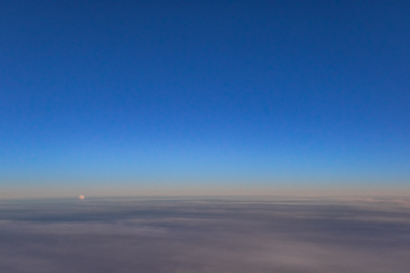 The full moon starts to rise above the clouds have seen in this aerial photograph