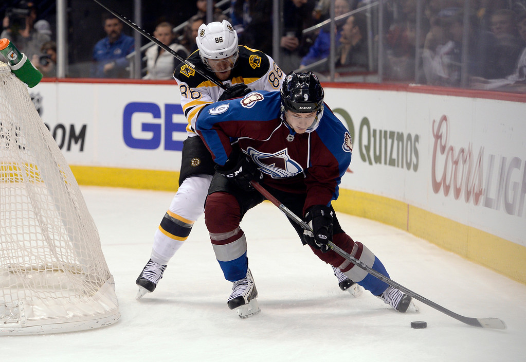 . DENVER, CO - JANUARY 21: Colorado Avalanche center Matt Duchene (9) works the puck behind the Bruins goal as he gets pressure from Boston Bruins defenseman Kevan Miller (86) during the first period January 21, 2015 at Pepsi Center. (Photo By John Leyba/The Denver Post)