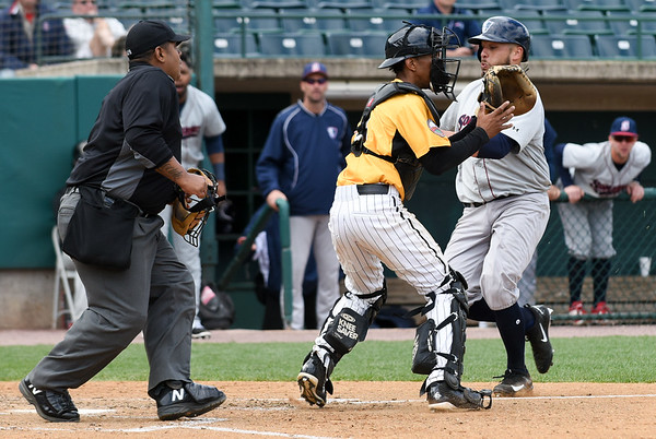 050317  Wesley Bunnell | Staff  New Britain Bees vs Somerset Patriots in a Wednesday morning game attended by areas school children. James Skelton (3) prepares to receive the throw home.