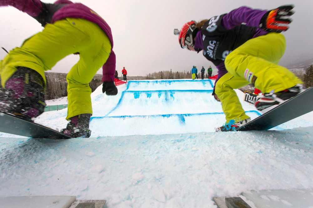 . In this image provided by Nathan Bilow Photography, two competitors head out of the starting gate at the snowboard cross team World Cup event in Telluride, Colo., Saturday, Dec. 15, 2012. (AP Photo/Nathan Bilow)