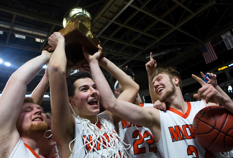 BANGOR, Maine -- 03/04/2017 -- Machias celebrates after defeating Greenville during their Class D boys basketball state championship at the Cross Insurance Center in Bangor Saturday. Ashley L. Conti | BDN