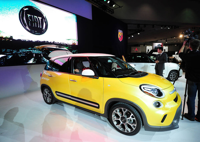 . The Fiat 500L Trekking is displayed at its world premiere at the Los Angeles Auto show  in Los Angeles, California on media preview day, November 28, 2012. The 500L is a five-door sub-compact minivan with seating for five and looks that borrow styling cues from the smaller 500 city car.  The LA Auto Show will open to the public on November 30 and runs through December 9AFP PHOTO / Robyn BECK/AFP/Getty Images