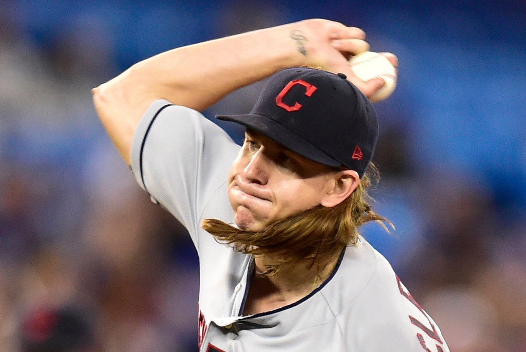 . Cleveland Indians starting pitcher Mike Clevinger throws against the Toronto Blue Jays during first-inning baseball game action in Toronto, Sunday, Sept. 9, 2018. (Frank Gunn)
