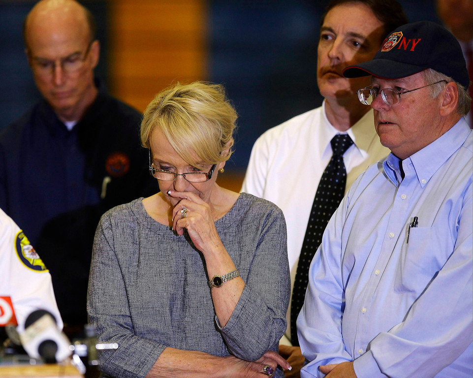 . Arizona Governor Jan Brewer (C) reacts during a news conference at Prescott High School in Prescott, Arizona July 1, 2013. Fire investigators in central Arizona launched a probe on Monday into how wind-driven flames closed in on and killed the 19 specially trained firemen in a tragedy that marked the greatest loss of life among firefighters in a U.S. wildland blaze in 80 years. REUTERS/Joshua Lott