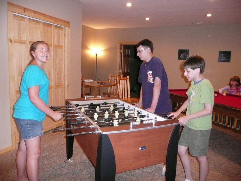 Katie, Jake and Andrew playing foosball.