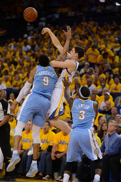 . Klay Thompson (11) of the Golden State Warriors passes over Andre Iguodala (9) of the Denver Nuggets in the third quarter in Game 4 of the first round NBA Playoffs April 28, 2013 at Oracle Arena. (Photo By John Leyba/The Denver Post)