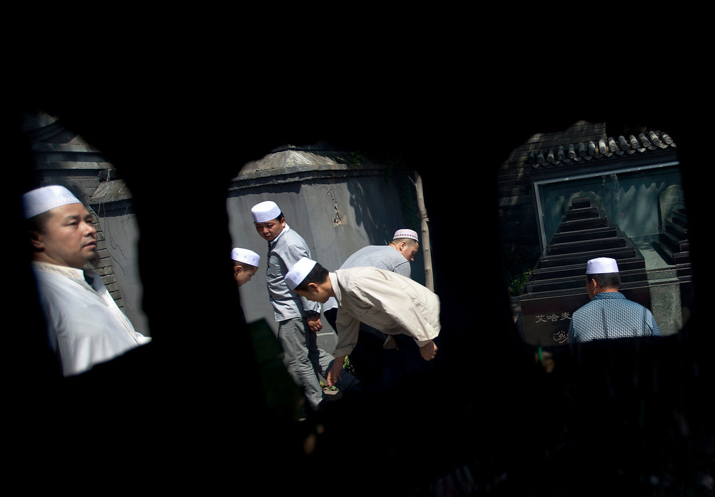 . Muslims attend an Eid al-Fitr morning prayer at the Niujie Mosque in Beijing, China Thursday, Aug. 8, 2013. Muslims in China celebrate the Eid al-Fitr that marks the end of the holy fasting month of Ramadan. (AP Photo/Andy Wong)