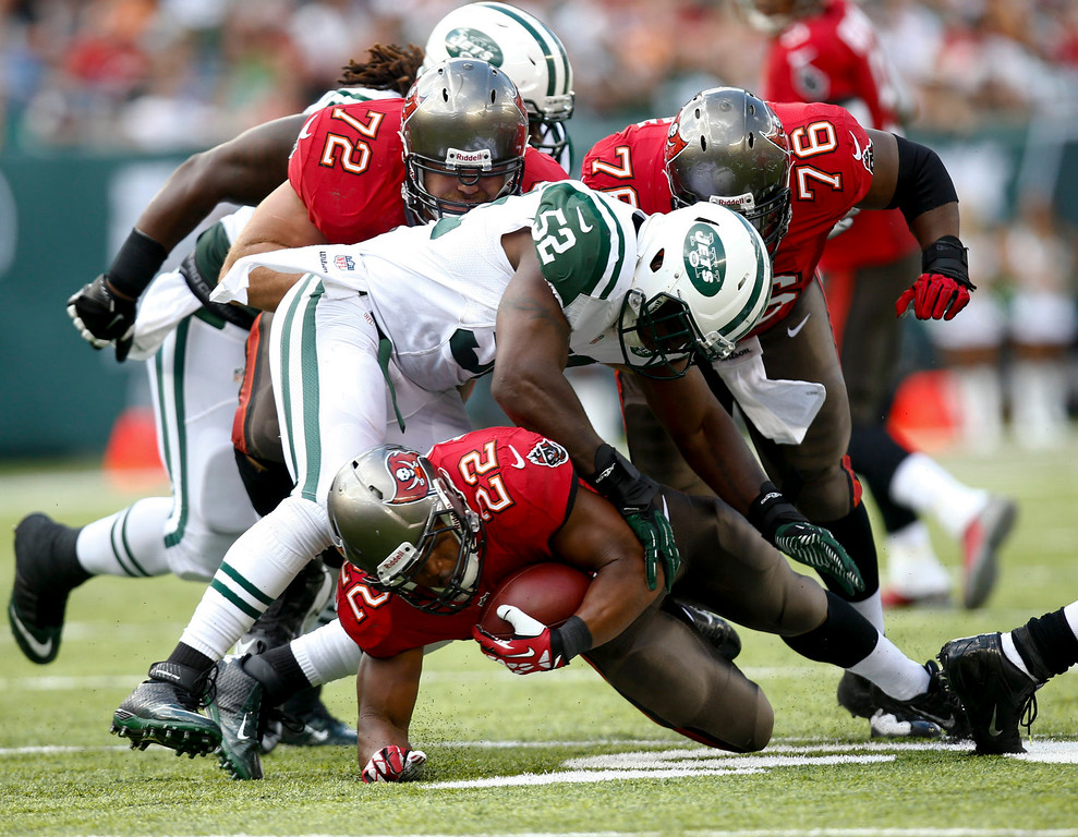 . David Harris #52 of the New York Jets takes down Doug Martin #22 of the Tampa Bay Buccaneers during their game at MetLife Stadium on September 8, 2013 in East Rutherford, New Jersey.  (Photo by Jeff Zelevansky/Getty Images)