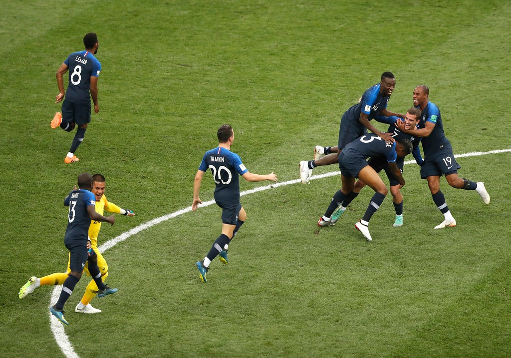 . French players celebrate at the end of the final match between France and Croatia at the 2018 soccer World Cup in the Luzhniki Stadium in Moscow, Russia, Sunday, July 15, 2018. France won 4-2. (AP Photo/Frank Augstein)