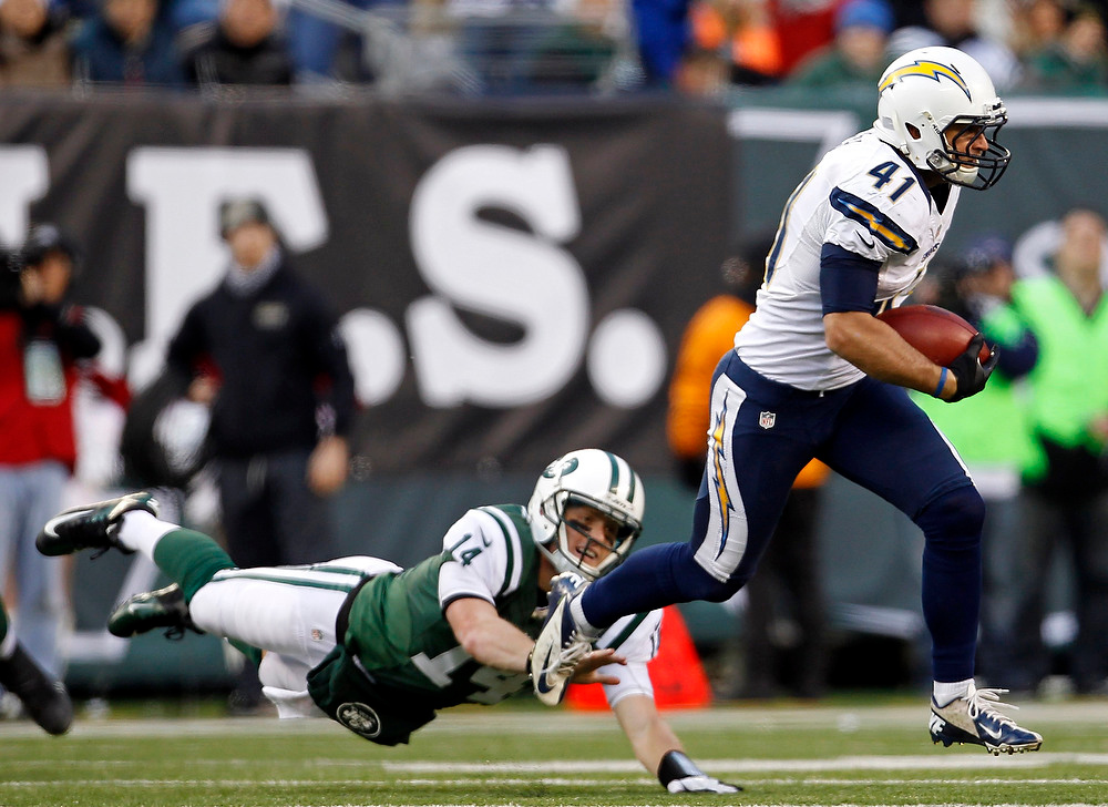 . San Diego Chargers strong safety Corey Lynch avoids New York Jets quarterback Greg McElroy after intercepting McElroy during the fourth quarter of their NFL football game in East Rutherford, New Jersey December 23, 2012.    REUTERS/Adam Hunger