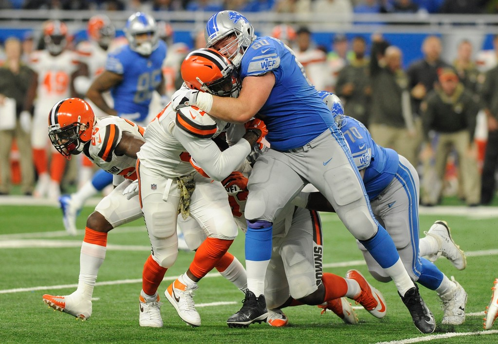 . Cleveland Browns outside linebacker Jamie Collins is tackled by Detroit Lions offensive guard Graham Glasgow (60) during the first half of an NFL football game, Sunday, Nov. 12, 2017, in Detroit. (AP Photo/Jose Juarez)