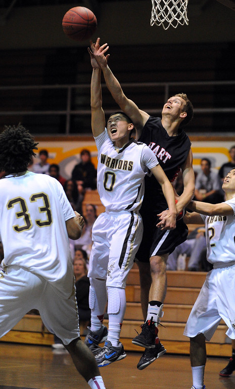 . TORRANCE - 02/15/2013 - (Staff Photo: Scott Varley/LANG) In a CIF Southern Section Division III-AAA second-round boys basketball matchup, West beat Hart 64-55. West\'s Ethan Kishimoto is fouled over the back by Nolyn Preston.