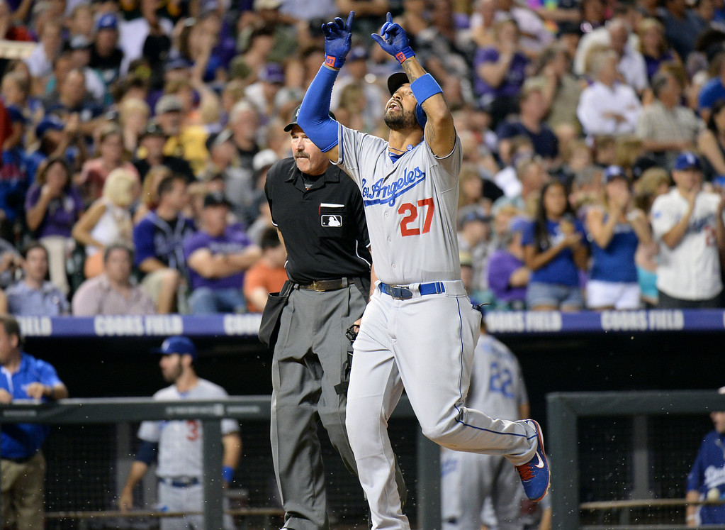 . DENVER, CO. - July 03: Matt Kemp of Los Angeles Dodgers (27) celebrate his home run in the 9th inning of the game against Colorado Rockies at Coors Field. Denver, Colorado. July 3, 2013. Los Angeles won 10-8. (Photo By Hyoung Chang/The Denver Post)