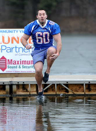 1/19/2019 Mike Orazzi | Staff Southington High School football coach Mike Drury during the 14th annual Sloper Plunge at Camp Slopers pond Saturday in Southington.