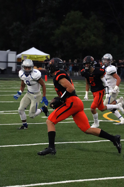 . Nicholas Pfeifer - The Morning Journal<br> North Olmsted\'s Dalton Diaz looks for a hole against Midview on Sept. 7.