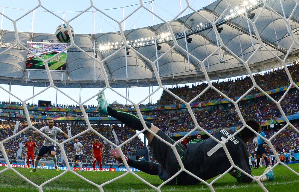 . Switzerland\'s goalkeeper Diego Benaglio saves a penalty shot by France\'s forward Karim Benzema during a Group E football match between Switzerland and France at the Fonte Nova Arena in Salvador during the 2014 FIFA World Cup on June 20, 2014.  (ANNE-CHRISTINE POUJOULAT/AFP/Getty Images)
