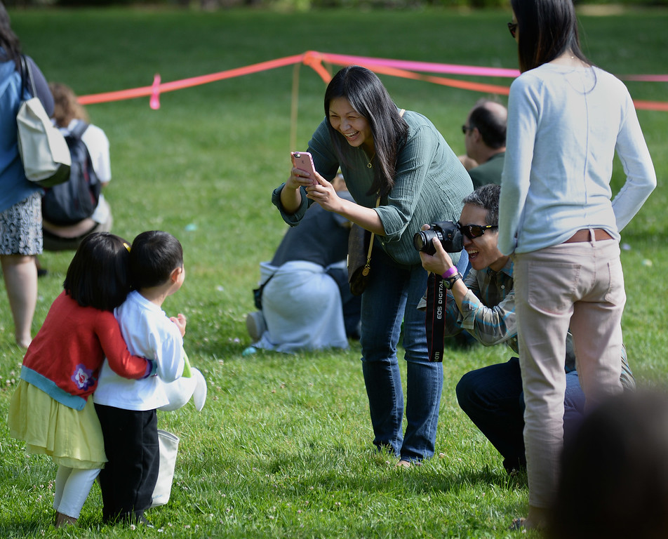 ". Kurt Yanagimachi, right, of Lafayette, and Annie Peters, left, of San Carlos, take photographs of cousins Olivia Peters, 3, and Tyler Yanagimachi,3, during the Town of Danville\'s ""Eggstravaganza\"" held at the Danville Community Center in Danville, Calif., on Saturday, April 12, 2014. The event featured egg hunts for children of all ages as well as fun activities and snacks. (Dan Honda/Bay Area News Group)"