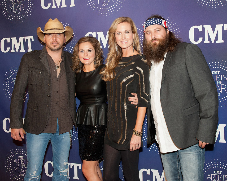 ". Jason Aldean, Jessica Ussery Aldean, Korie Robertson and Willie Robertson attend the 2012 CMT ""Artists Of The Year\"" Awards at The Factory At Franklin on December 3, 2012 in Franklin, Tennessee.  (Photo by Erika Goldring/Getty Images)"