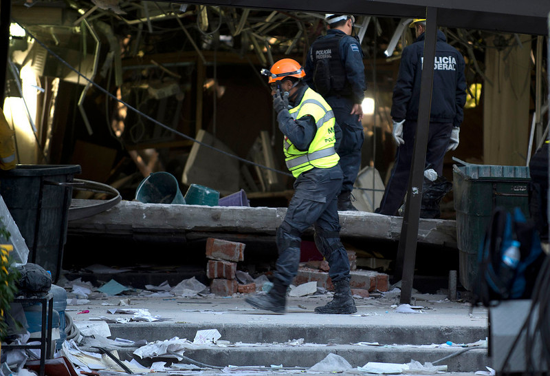 . Soldiers, federal policemen and firefighters remove debris from the headquarters of state-owned Mexican oil giant Pemex in Mexico City on February 1, 2013, following a blast inside the building. An explosion rocked the skyscraper, leaving up to now 32 dead and 100 injured, as a plume of black smoke billowed from the 54-floor tower, according to official sources. AFP PHOTO/ YURI CORTEZ/AFP/Getty Images