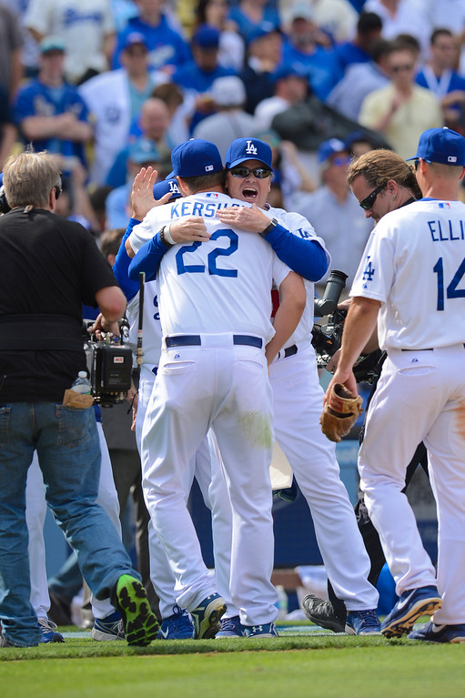 . Dodger\'s Clayton Kershaw is congratulated after winning opening day at Dodger Stadium Monday.  Dodgers defeated the Giants 4-0.  Photo by David Crane/Los Angeles Daily News.