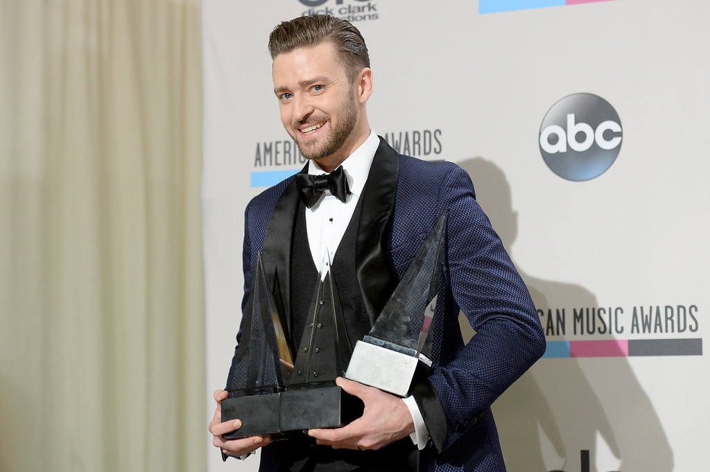 . Singer Justin Timberlake, winner of the Favorite Soul/R&B Male Artist, Favorite Pop/Rock Male Artist, and Favorite Soul/R&B Album awards, poses in the press room during the 2013 American Music Awards at Nokia Theatre L.A. Live on November 24, 2013 in Los Angeles, California.  (Photo by Jason Merritt/Getty Images)