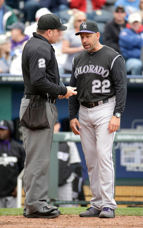 . Colorado Rockies manager Walt Weiss questions a call with home plate umpire Dan Bellino during the fourth inning of a baseball game against the Kansas City Royals Wednesday, May 14, 2014 in Kansas City, Mo. (AP Photo/Charlie Riedel)