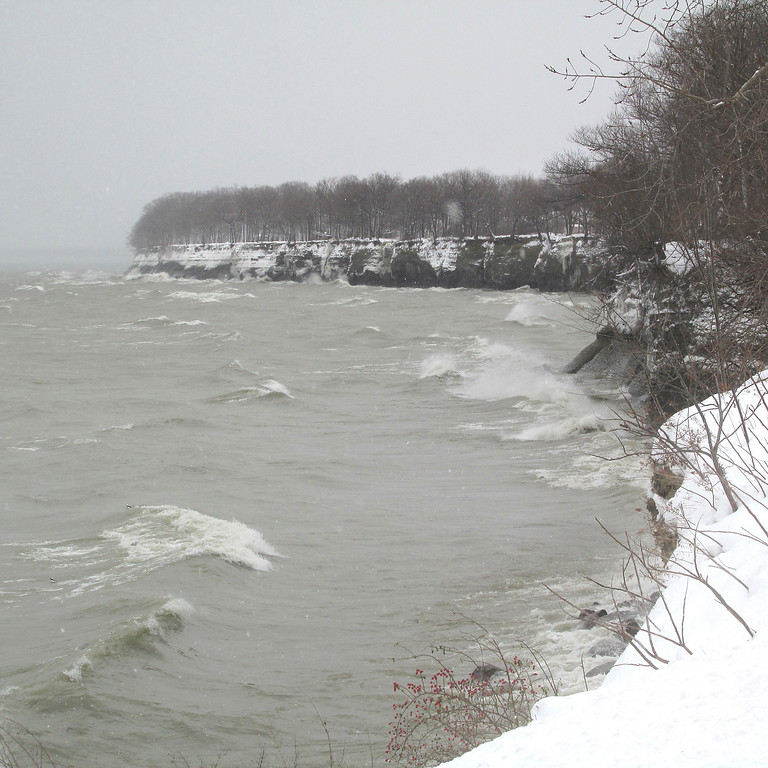 . In this Tuesday, Dec. 26, 2017 photo, the surf from Lake Erie pounds the shore in Dunkirk, N.Y., driven by cold winds with lake effect snow. The National Weather Service said that strong westerly winds over Lake Erie picked up moisture, developed into snow and converged with opposing winds, dumping snow in a band along the shore from Ohio to New York. (Damian Sebouhian/The Observer via AP)