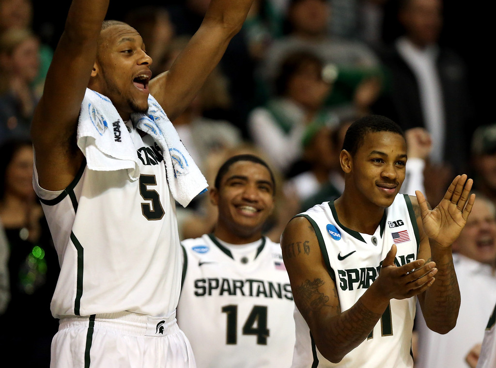. AUBURN HILLS, MI - MARCH 23:  (L-R) Adreian Payne #5, Gary Harris #14 and Keith Appling #11 of the Michigan State Spartans celebrate on the bench against the Memphis Tigers during the third round of the 2013 NCAA Men\'s Basketball Tournament at The Palace of Auburn Hills on March 23, 2013 in Auburn Hills, Michigan.  (Photo by Jonathan Daniel/Getty Images)