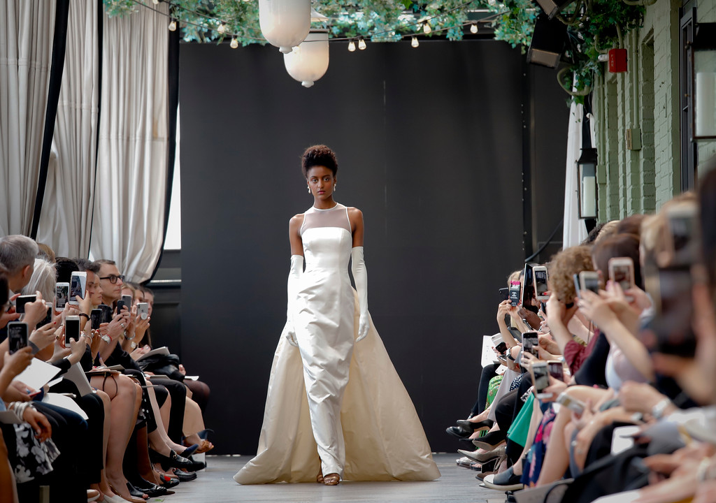 . The first-ever bridal gown from the late fashion designer Amsale Aberra, created in 1990, is modeled after the unveiling of the latest collection from Amsale, during Bridal Fashion Week, Friday April 13, 2018 in New York. (AP Photo/Bebeto Matthews)