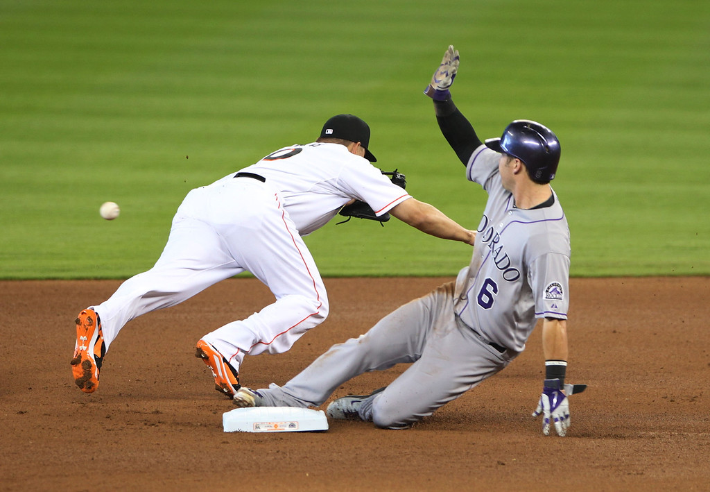 . Second baseman Jeff baker #10 of the Miami Marlins cannot make the tag against Corey Dickerson #6 of the Colorado Rockies during the first inning at Marlins Park on April 3, 2014 in Miami, Florida.  (Photo by Marc Serota/Getty Images)
