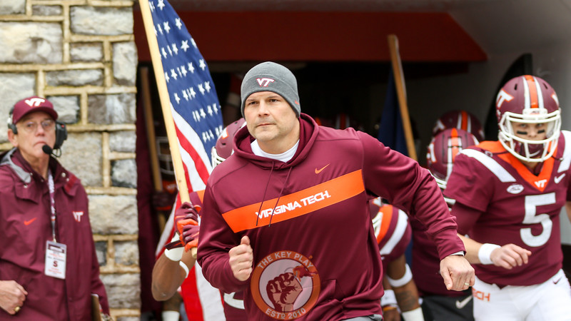 Hokies head coach Justin Fuente runs out of the tunnel during Enter Sandman before kickoff. (Mark Umansky/TheKeyPlay.com)