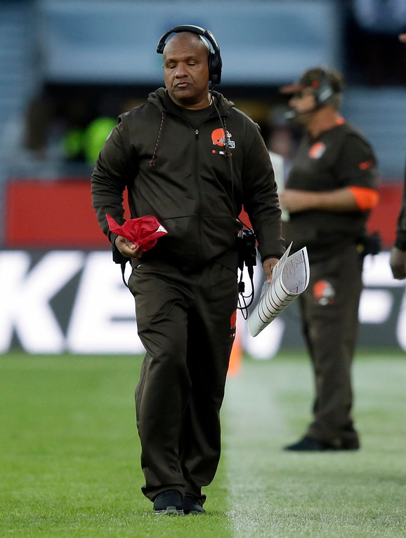 . Cleveland Browns head coach Hue Jackson holds a challenge flag on the sidelines during the second half of an NFL football game against Minnesota Vikings at Twickenham Stadium in London, Sunday Oct. 29, 2017. The Vikings won 33-16. (AP Photo/Tim Ireland)