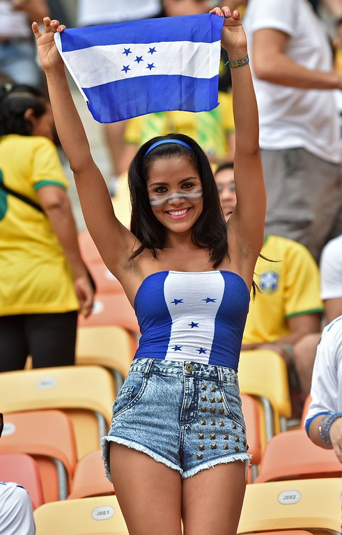 . A Honduras fan cheers for her team before the start of the Group E football match between Honduras and Switzerland at the Amazonia Arena in Manaus during the 2014 FIFA World Cup on June 25, 2014.  AFP PHOTO / RODRIGO  ARANGUA/AFP/Getty Images