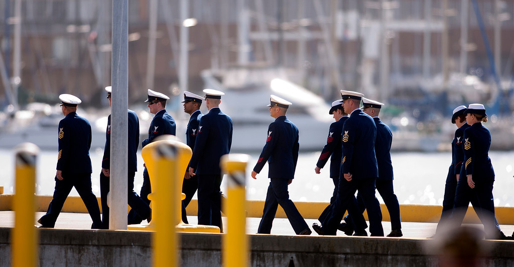. Crew members of the Coast Guard Cutter Waesche walk to a memorial service for their late shipmate, U.S. Coast Guard Boatswain\'s Mate Third Class Travis R. Obendorf, Thursday, Jan. 30, 2014 on Coast Guard Island in Alameda, Calif. Obendorf suffered fatal injuries while performing his duties aboard the Waesche as part of a search and rescue off the coast of the Alaska in November 2013. (D. Ross Cameron/Bay Area News Group)