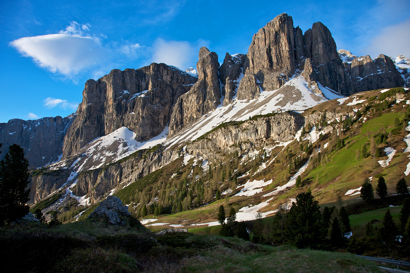Gardena Pass, Dolomite Peaks tower high in the early summer morning light.