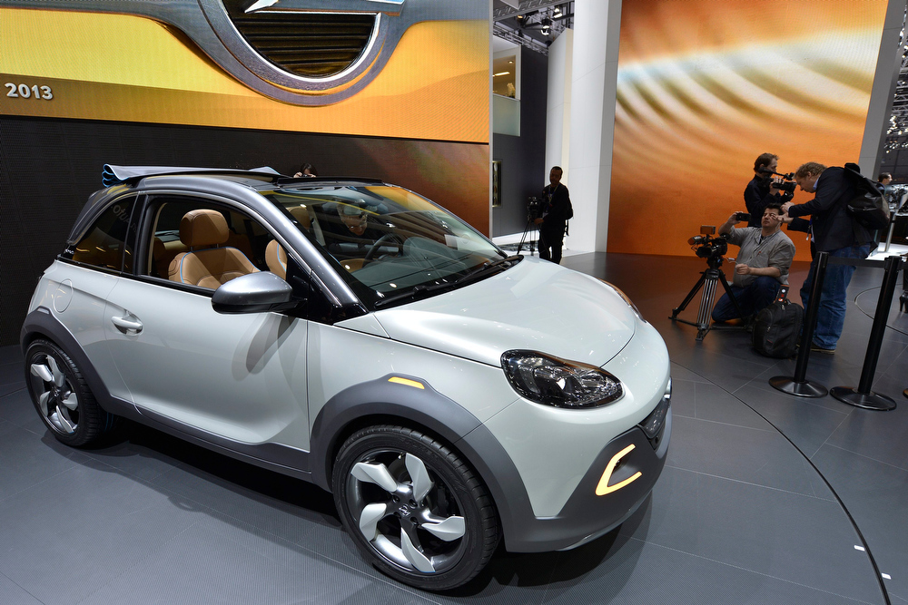 . The new Opel Adam Rocks is shown during the press day at the 83rd Geneva International Motor Show in Geneva, Switzerland, Tuesday, March 5, 2013. The Motor Show will open its gates to the public from 7th to 17th March presenting more than 260 exhibitors and more than 130 world and European premieres. (AP Photo/Keystone, Martial Trezzini)