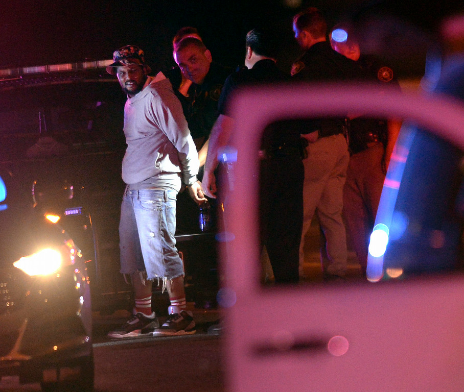 . Rapper Quincey Hanley, better known by his stage name Schoolboy Q, was put into handcuffs as Denver Police investigated a shooting that occurred at Red Rocks Amphitheater Thursday night, June 19, 2014.  Photo by Karl Gehring/The Denver Post