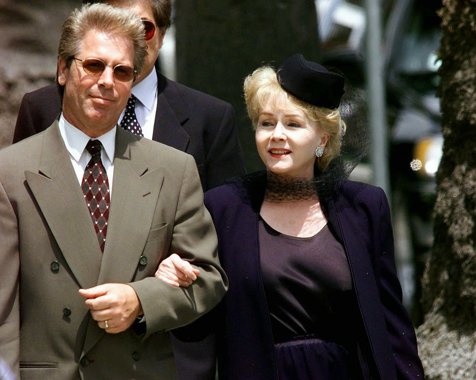 . Actress Debbie Reynolds arrives with an unidentified person to the funeral of legendary entertainer Frank Sinatra at the Church of the Good Shepherd in Beverly Hills, Calif., Wednesday, May 20, 1998. (AP Photo/Kevork Djansezian)