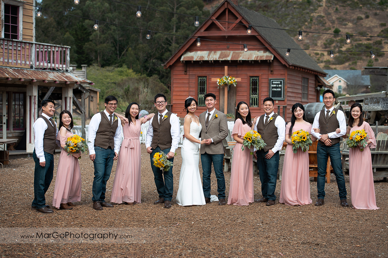bridal party in vanity fair pose at Long Branch Saloon & Farms in Half Moon Bay