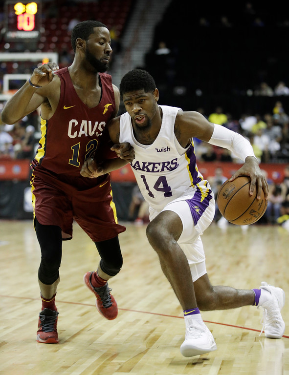 . Los Angeles Lakers\' Malik Newman drives into Cleveland Cavaliers\' Scoochie Smith during the second half of an NBA summer league basketball game, Monday, July 16, 2018, in Las Vegas. (AP Photo/John Locher)