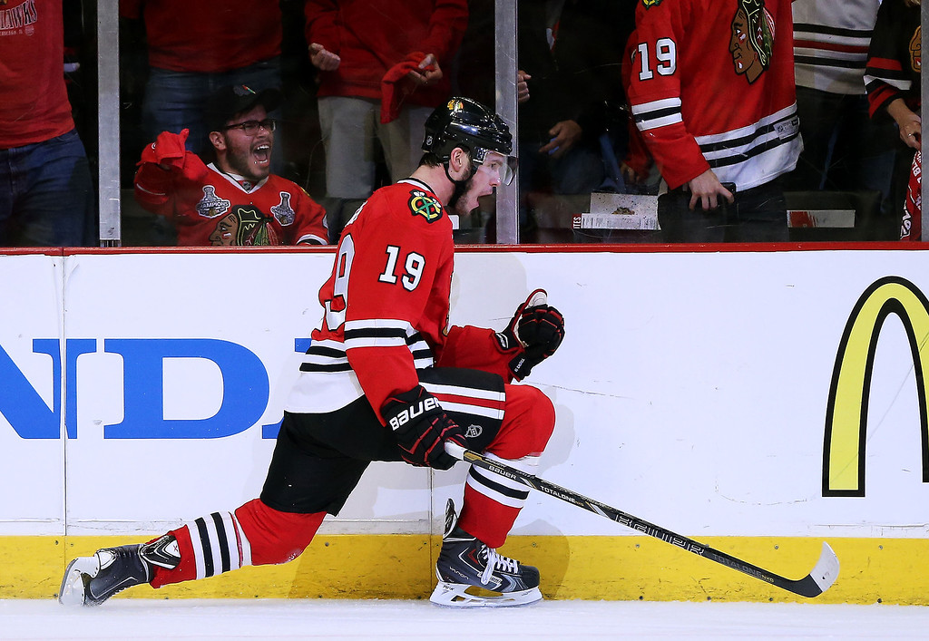 . Jonathan Toews #19 of the Chicago Blackhawks celebrates his in the third period goal against the Los Angeles Kings in Game One of the Western Conference Final during the 2014 Stanley Cup Playoffs at United Center on May 18, 2014 in Chicago, Illinois.  (Photo by Jonathan Daniel/Getty Images)