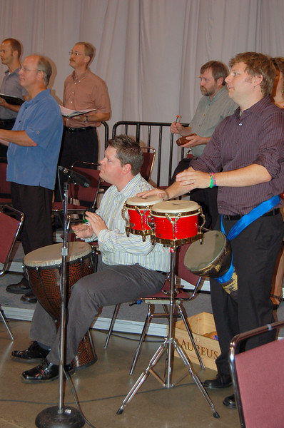 Percussionists rehearse for opening worship.