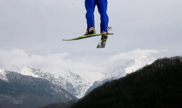 . An unidentified athlete makes his trial jump during the ski jumping portion of the Nordic combined Gundersen large hill team competition at the 2014 Winter Olympics, Thursday, Feb. 20, 2014, in Krasnaya Polyana, Russia. (AP Photo/Dmitry Lovetsky)
