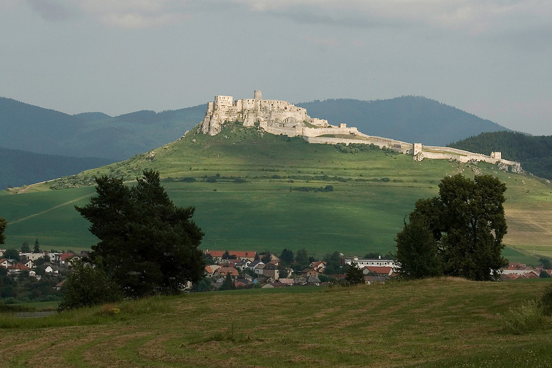 Spiš region of eastern Slovakia, where rolling forested hills and distant high peaks resemble the Cascades of the United States. Along the way, explore the 12th-century Spiš Castle. Poised on a limestone cliff at the crossroads of medieval merchant routes, this World Heritage site is one of the largest and most distinctive castles in Central Europe.